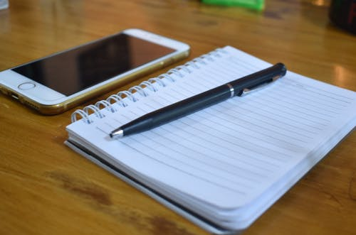 Free stock photo of notebook, notebook and smartphone, pen