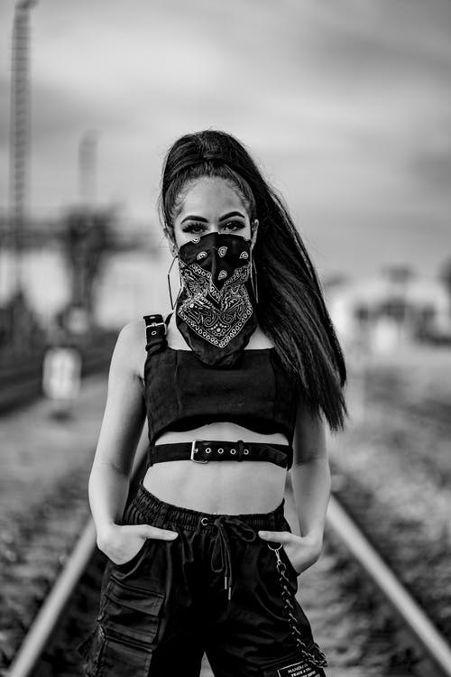 Grayscale Photo of Woman Wearing Black Handkerchief on Her Face