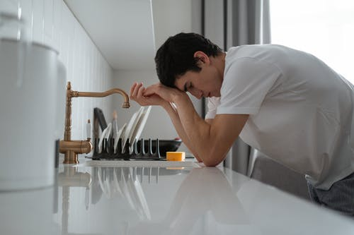 Man Leaning on the Kitchen Counter