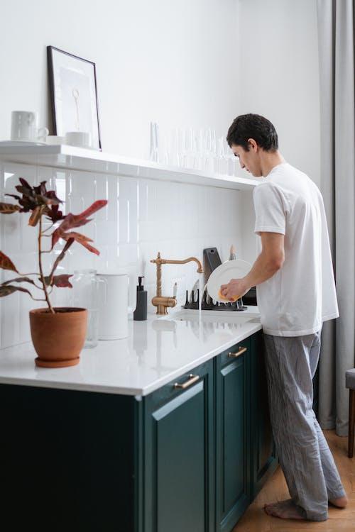A Man Washing Dishes