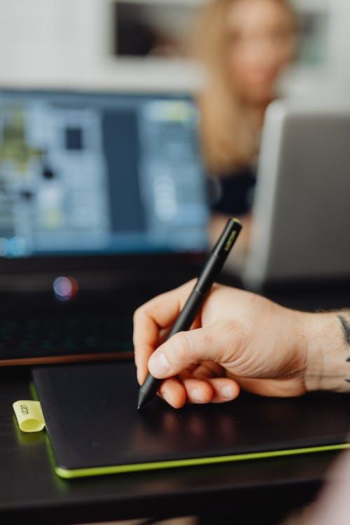 Person Holding Black Stylus Pen