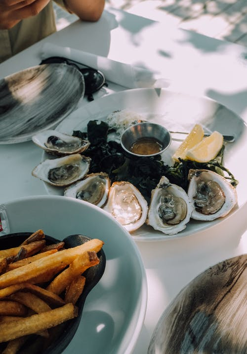 Fresh Oysters on White Ceramic Plate