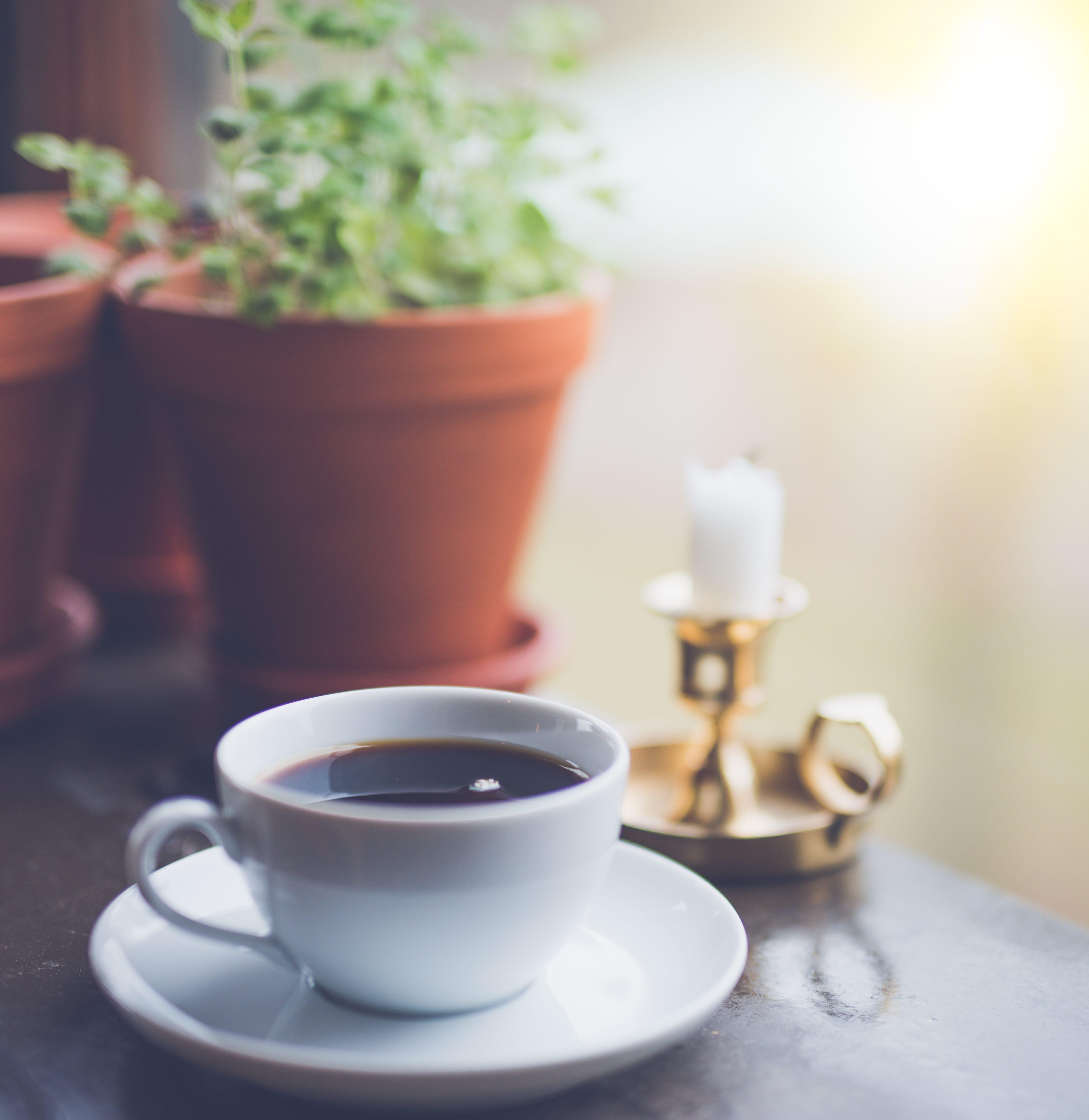Coffee Mug on White Saucer