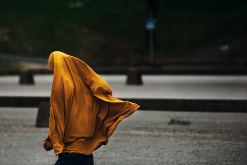 Person Covered With Yellow Blanket