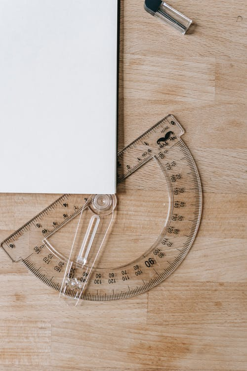 Protractor and clear paper on table