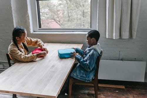 Multiracial schoolchildren having breakfast during break