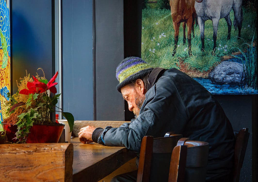 Free stock photo of Old man sitting in a bar