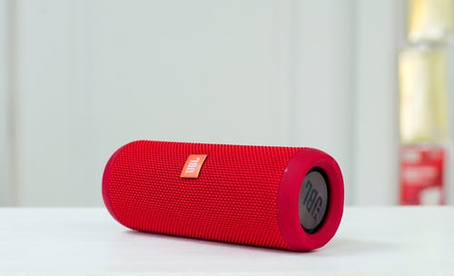 Red Jbl Portable Speaker on White Table