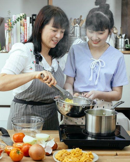Bonding females serving homemade pasta