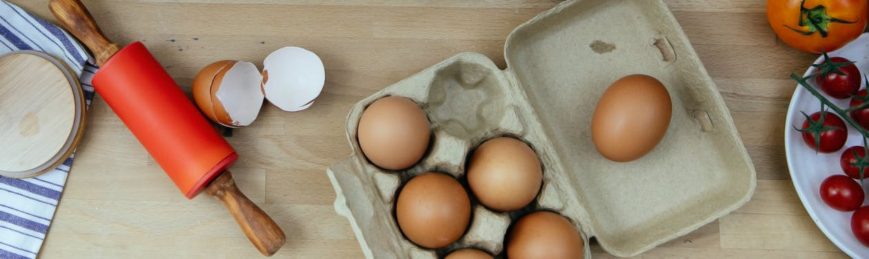 Egg placed on table in kitchen