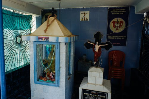 Christian prayer corner in rural hut