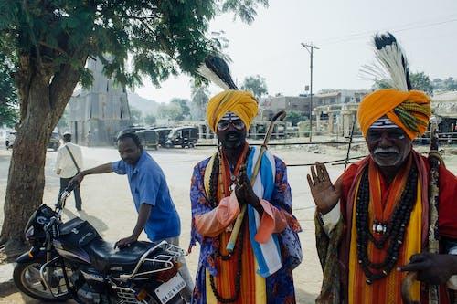Ethnic men in street in traditional costume