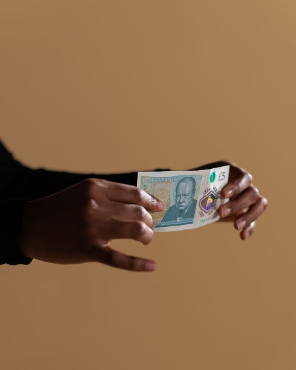 Person Holding a Banknote