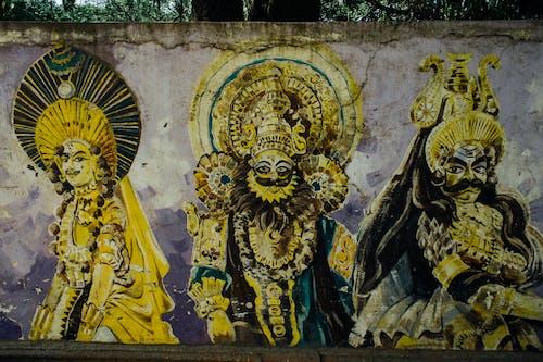 Graffiti of ancient Indian gods on shabby wall