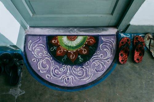 Colourful picture of oriental rug on floor near front door