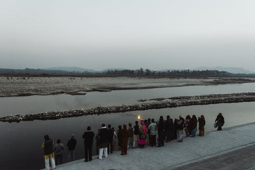 People standing on embankment near river