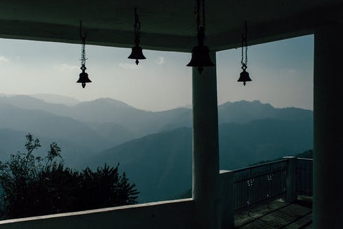 Spectacular view from window in old house located in hilly area in morning time