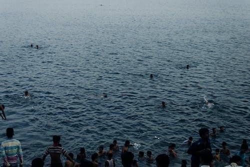 Indian people swimming in rippling sea