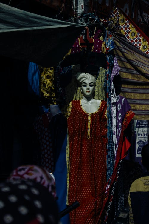 Mannequin dressed in long clothes in market