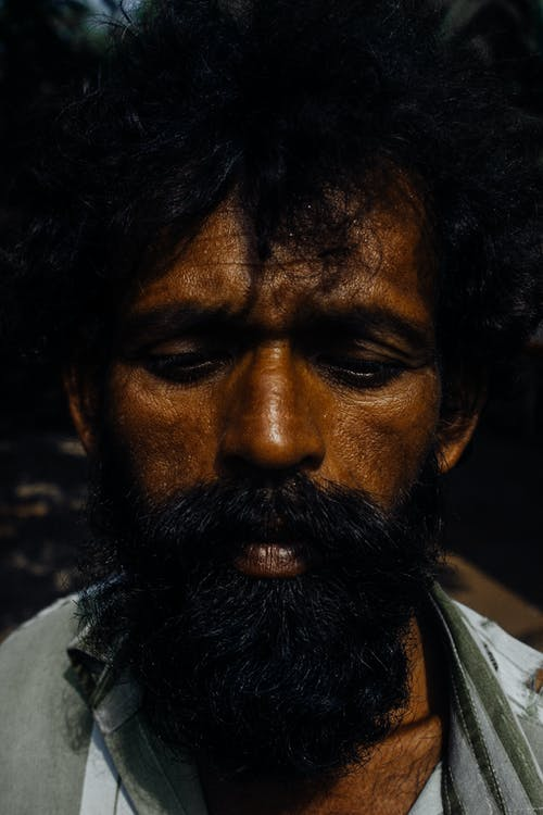 Upset ethnic bearded man with messy hair