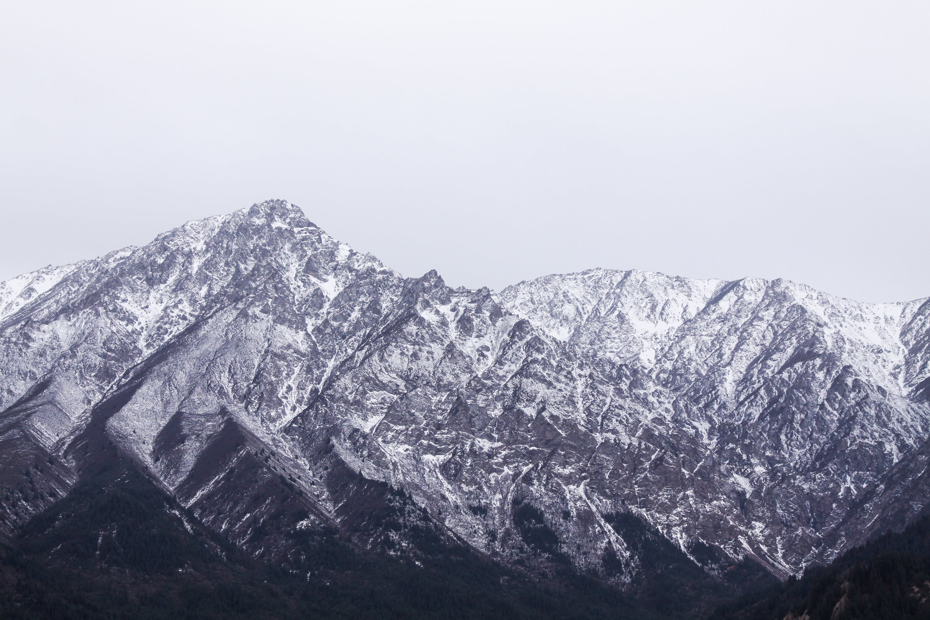Aerial Photography of Rock Mountain Covered With Snow