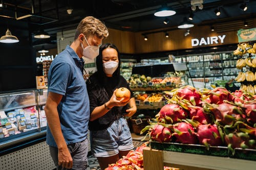Couple Buying Fresh Fruits During Pandemic