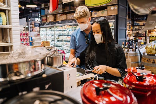 Couple Looking At Kitchenwares Inside A Store