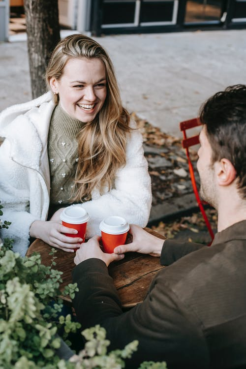 Happy couple having date in cafe