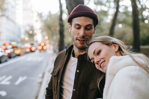 Smiling couple having romantic date on city street