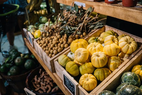 Yellow and Green Squash on Brown Wooden Crate