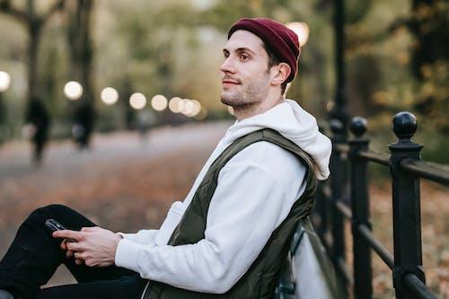 Content man looking away in park