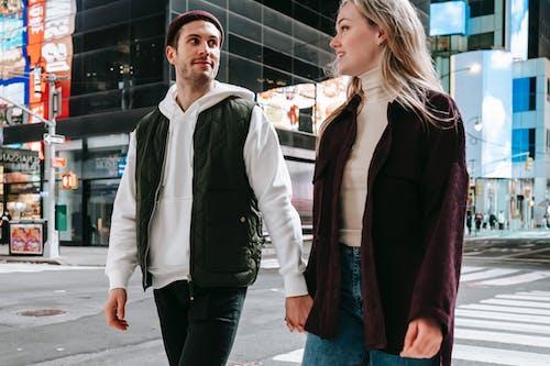 Romantic couple walking on crosswalk