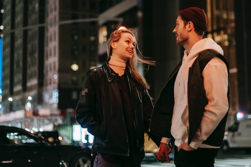Positive couple standing near road