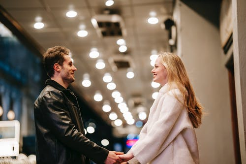 Smiling couple standing in hall of subway