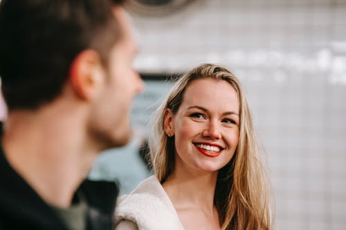Happy woman with anonymous man