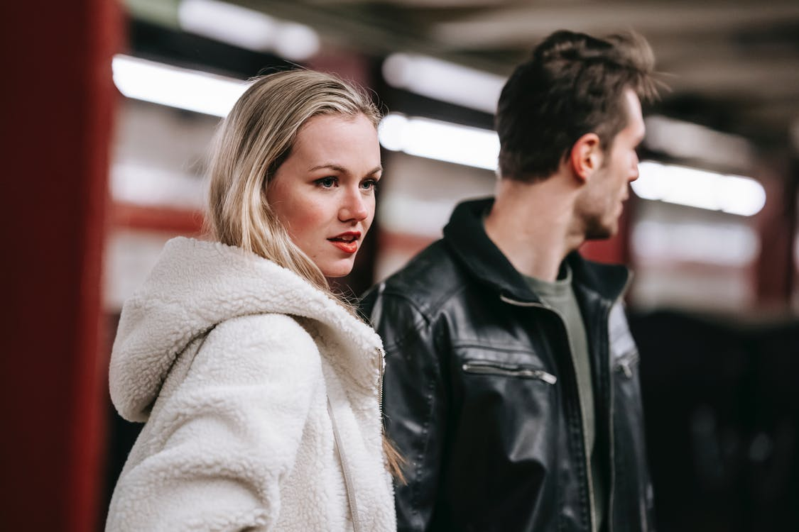 Couple standing in underground station together