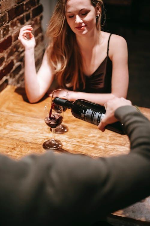 Couple enjoying romantic date in pub