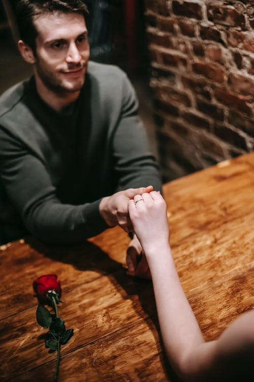 Male proposing to female on date in restaurant