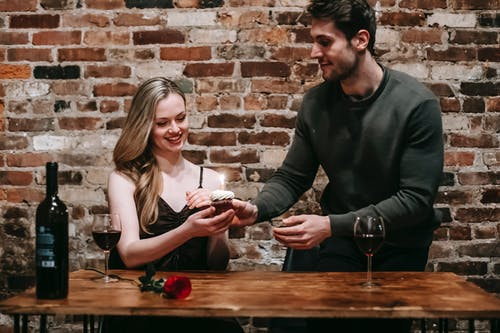 Cheerful couple spending romantic date in restaurant