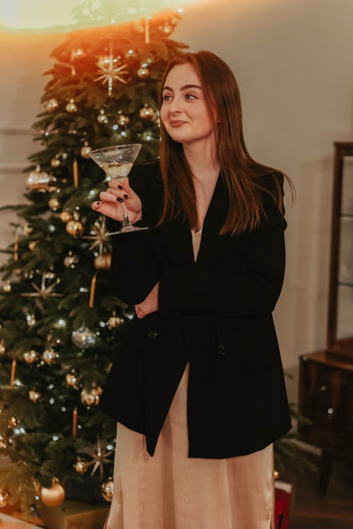 Woman in Black Coat Holding Clear Wine Glass