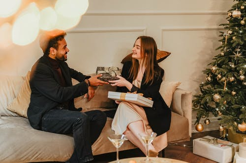 Man And Woman Exchanging Gifts