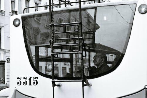 Elderly man with people in trolleybus