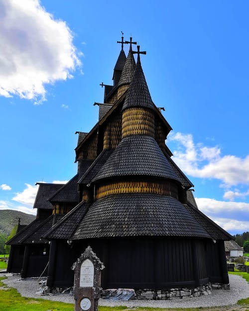 Black and Brown Church Under Blue Sky