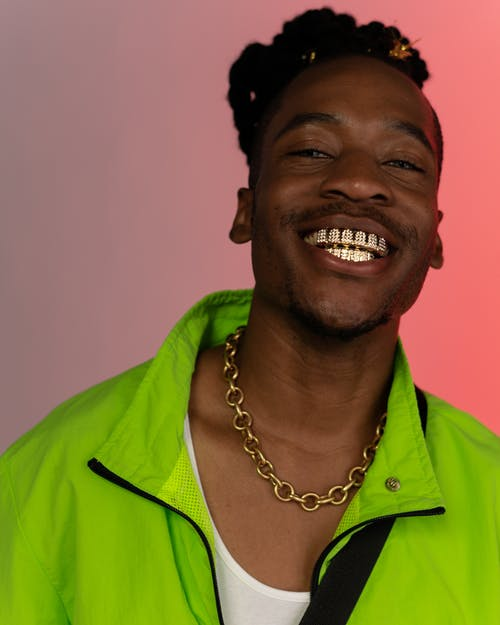 Man in Green Button Up Shirt Smiling