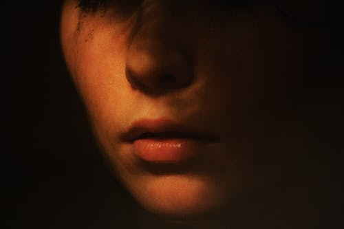 Crop woman in dark room