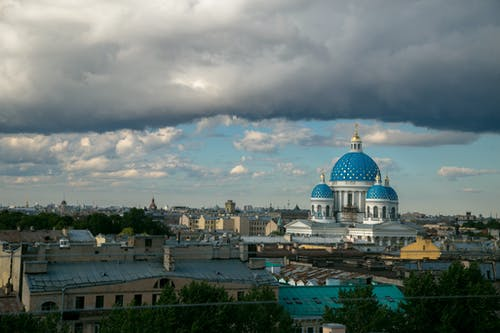 From above of Saint Petersburg cityscape with many buildings and famous Trinity cathedral under cloudy blue sky