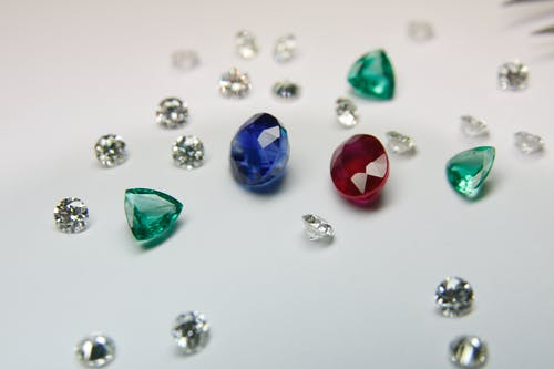 Collection of colorful precious stones scattered on table