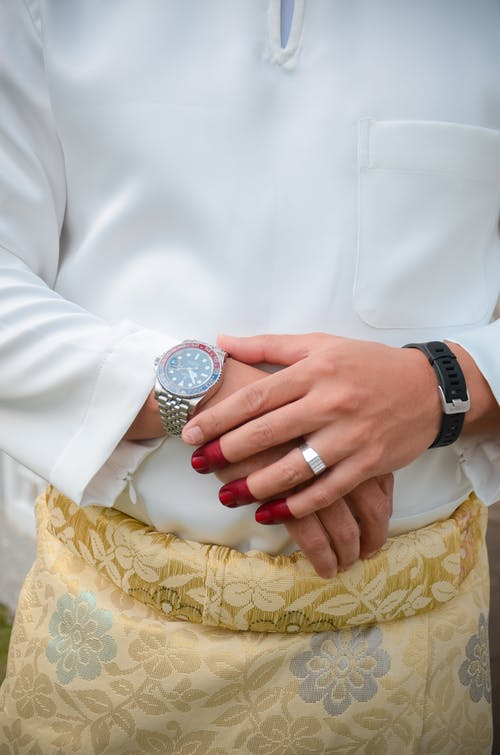 Person Wearing Silver and Black Round Analog Watch