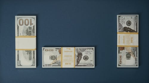 Banknotes On Blue Surface
