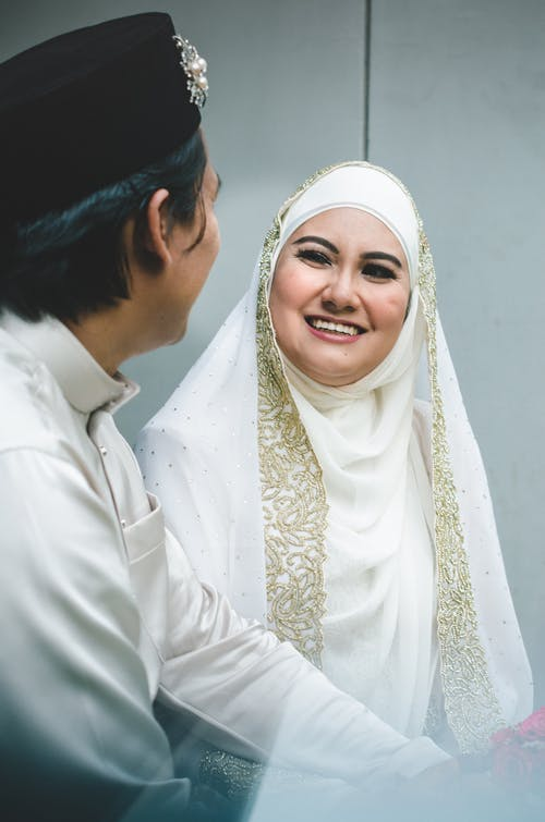 Man in White Thobe Beside Woman in White Hijab